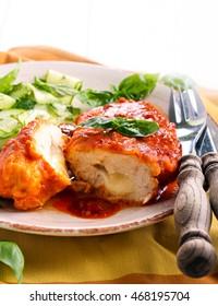 Mozzarella stuffed chicken breast in tomato sauce