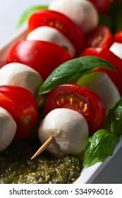 mozzarella with tomato , basil  and pesto sauce