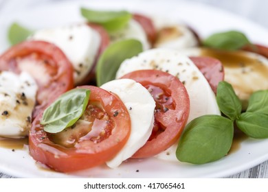 Mozzarella, Tomatoes and Balasmico Dressing (close-up shot; selective focus)