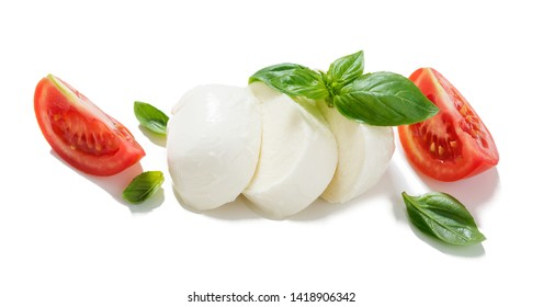 Mozzarella with tomatoes and basil leaves isolated on white background.