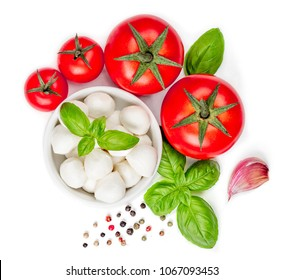 Mozzarella, tomatoes, basil and spices isolated on white background, close up. Food Ingredients, view from above