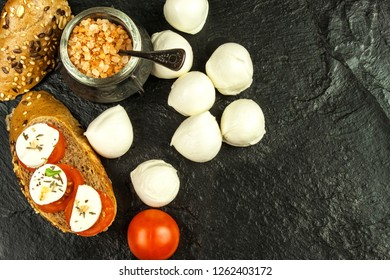 Mozzarella and tomatoes on slate plate. Diet food. Food preparation. Sale of cheeses. Protein diet.