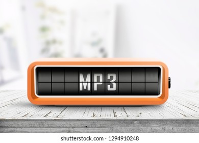 Mp3 message on a analog device in a bright room on a wooden table