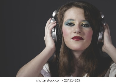 Mp3, young girl listening music with huge headphones
