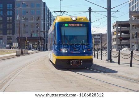 MPLS, MN/USA – APRIL 22, 2018: Light rail commuter train along green line transit corridor in Prospect Park neighborhood of Minneapolis.