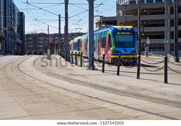 MPLS, MN/USA – APRIL 22, 2018: Light rail commuter train along green line transit corridor in Prospect Park neighborhood of Minneapolis.