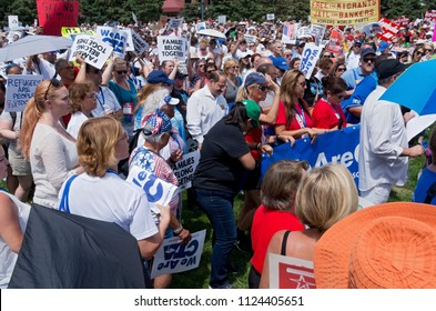MPLS, MN/USA – JUNE 30, 2018: Protesters gather holding signs as part of the national rally Families Belong Together in Minneapolis Convention Center plaza.