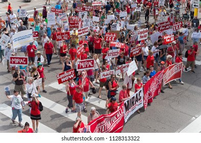 MPLS, MN/USA – JUNE 30, 2018: Protesters march in the streets to support the national rally Families Belong Together in downtown Minneapolis.