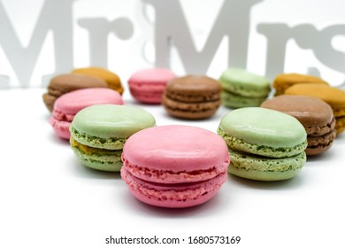 mr and mrs sign decorated with macarons as heart isolated on white background