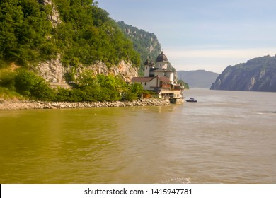 Mraconia Monastery on shores cruising through the Iron Gate gorges on the Danube River between Serbia and Romania.