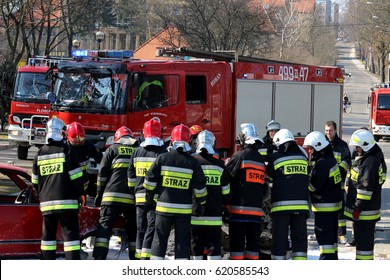 Mragowo, Poland, Exercises simulating a traffic accident - March 18, 2015: Firefighters in action, car accident