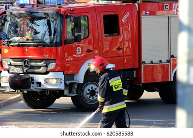 Mragowo, Poland, Exercises simulating a traffic accident - March 18, 2015: Firefighter and fire truck Mercedes-Benz Atego