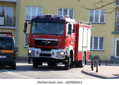 Mragowo, Poland, Exercises simulating a traffic accident - March 18, 2015: Car firefighting MAN