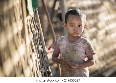Mrauk U, MYANMAR - DEC 15, 2014: Unidentified Burmese boy in Mrauk U on December 15, 2014 in Mrauk U, Myanmar.