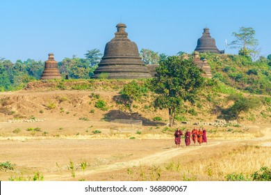 MRAUK U, MYANMAR - JAN 18: The monks walk to to receive food on Jan 18, 2016 in Mrauk U, Myanmar. Mrauk U is an archaeologically important town in northern Rakhine State, Myanmar.