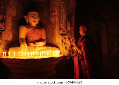 MRAUK U, MYANMAR -JAN 18: Unidentified Buddhism neophyte prays in Andaw Thein temple on January 18, 2016 in Mrauk U, Myanmar. Southeast Asian neophyte praying in a Buddihist temple