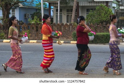 Mrauk u Myanmar on April 03, 2016: women are walking to the temple