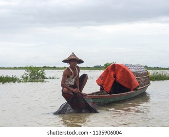 Mrauk u Myanmar on August 05, 2016: Fisherman with traditional boat
