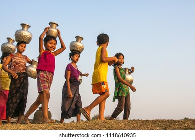 Mrauk u Myanmar on March 20, 2016: Smile of community were carrying water from pond.