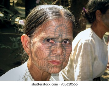 MRAUK U, RAKHINE STATE, MYANMAR - FEBRUARY 15, 2012 : Portrait of Elderly Chin Woman Facial Tattoos with Red Mouth from Areca Consumption, Lemro River Valley.