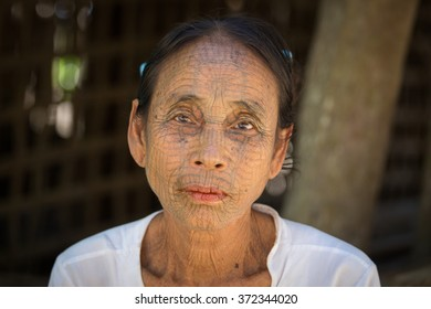 MRAUK-U, MYANMAR - JANUARY 27, 2016: The portrait of Chin woman with spider tattoo. Chin people, also known as the Kukis are a number of Tibeto Burman tribal people.