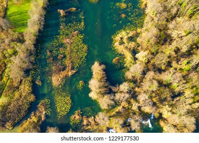 Mreznica river in Croatia from air, drone shoot, top down view, Karlovac county, green nature, wood and waterfalls in autumn