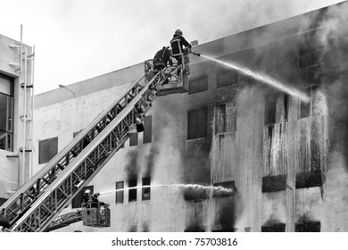MRIEHEL, MALTA - APR 12 - Firefighters battle a fierce fire which engulfed Drop Chemicals Ltd factory which specializes in the production of domestic and industrial detergents, on April 12, 2011 in Mriehel, Malta.