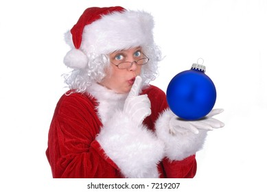 Mrs. Claus with a Christmas ball in her hand isolated over white