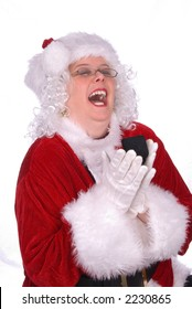 Mrs. Claus is laughing loudly