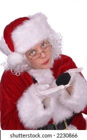 Mrs. Claus is showing a ring box