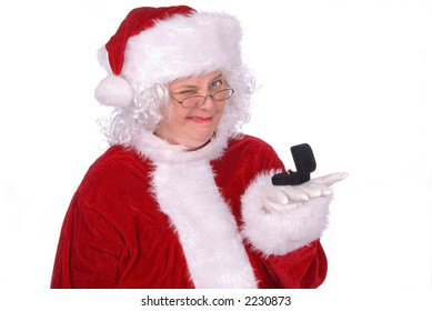 Mrs. Claus winks while holding a ring box