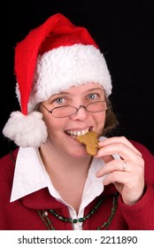 Mrs. Santa Claus bites a gingerbread cookie.....mmmmmmmmm, Christmasy