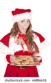 Mrs Santa is holding a big plate of cookies.