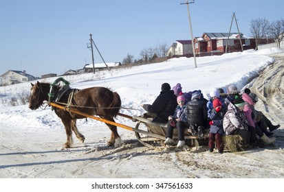 Mstera,Russia-February 21,2015:Horse carries sled and children on road in winter February 21,2015 in Mstere,Russia