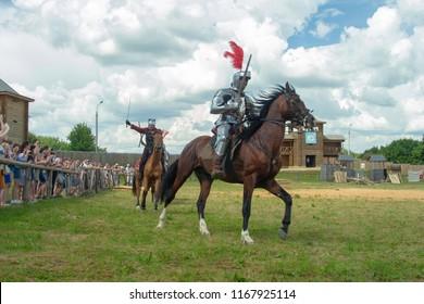 "MSTISLAVL, REPUBLIC OF BELARUS - AUGUST 04-05, 2018: Festival of medieval culture ""Knights Fest. Mstislavl 2018"". The battle of knights on horses."