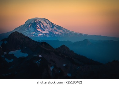 Mt. Adams Sunset afterglow with snow on its peak photographed from Mt. Rainier National Park