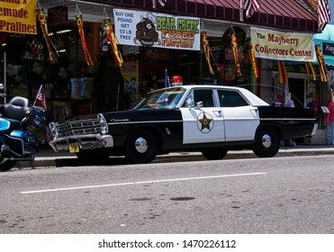 Mt. Airy, NC/USA August, 4, 2019  This old Mt. Airy Sheriff's car was sitting outside of a confectionery shop along Main Street. Inside of the vehicle was a custom leather jacket.