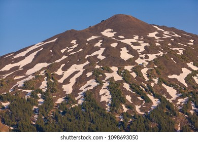 MT BACHELOR, OREGON, USA -  JULY 13, 2009: Mount Bachelor, 9,068 feet (2,764 meters), a volcano in the Cascade Range of Central Oregon, patches of snow and timberline.