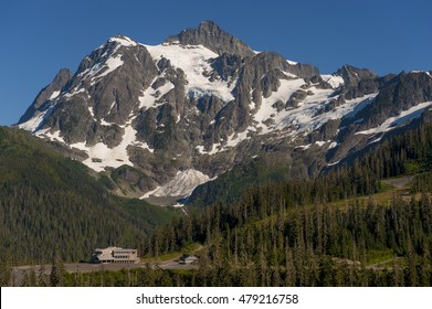Mt. Baker Ski Area. White Salmon Lodge is dwarfed by Mt. Shuksan during a glorious summer day in the Mt. Baker Recreation area, Washington State.