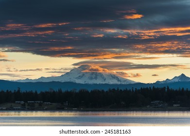 Mt. Baker Sunrise. A very dramatic sunrise paints Mt. Baker with a lovely warm hue. Taken from Lummi Island in the San Juan Islands of Puget Sound in western Washington State.