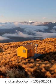 Mt Brown Hut in sun-fired tussock, West Coast, New Zealand