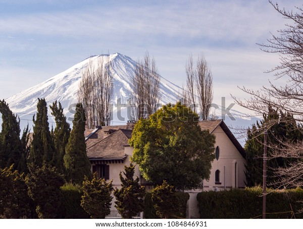 Mt. Fuji is behind the house.