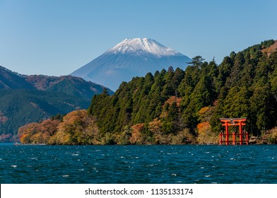 Mt. Fuji and a big red Torii on the Ashinoko Lake under blue clear sky background. View from Hakone in Japan