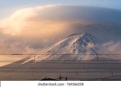 Mt. Fuji with the cloudy hat on the top of mountain in early morning during the sunrise