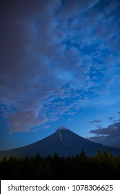 Mt. Fuji at Dusk in Summer with the Flashlights of Climbers