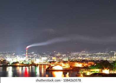 "Mt. Fuji with the ""Factory Night view"" in the spring seen from the ""Tagonoura minato Park"", Shizuoka, Japan."
