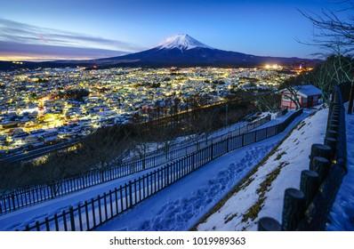 Mt Fuji and Fujiyoshida city at twilight, Japan