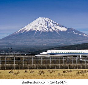 Mt. Fuji in Japan with passing train.
