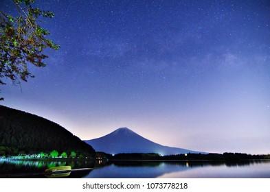 Mt. Fuji and the Milky Way in the spring seen at Lake TANUKIKO, Shizuoka,Japan.