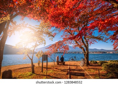 Mt. Fuji over Lake Kawaguchiko with autumn foliage and couple love at sunrise in Fujikawaguchiko, Japan.